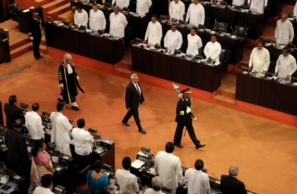Sri Lankan president Gotabaya Rajapaksa, center, along with speaker Karu Jayasuriya, center left, walk in the well of the house as he arrives to addre...
