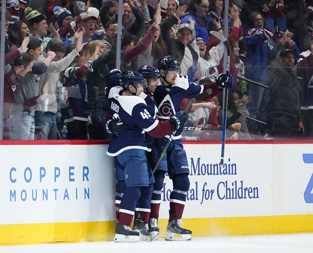 Colorado Avalanche center Pierre-Edouard Bellemare, center, celebrates a goal against the St. Louis Blues with teammates Samuel Girard (49) and Valeri...