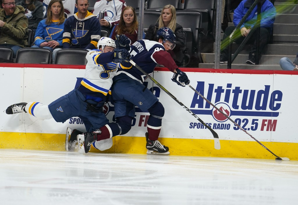 St. Louis Blues defenseman Vince Dunn (29) falls against Colorado Avalanche left wing Andre Burakovsky (95) during the third period of an NHL hockey g...
