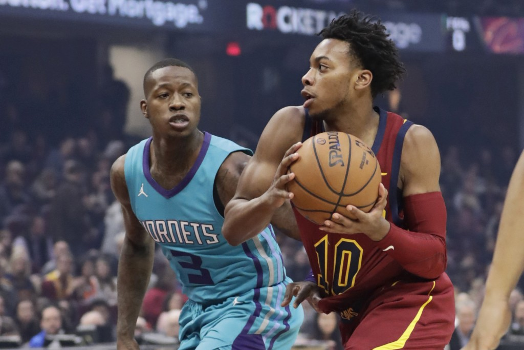 Cleveland Cavaliers' Darius Garland (10) drives past Charlotte Hornets' Terry Rozier (3) in the first half of an NBA basketball game, Thursday, Jan. 2...