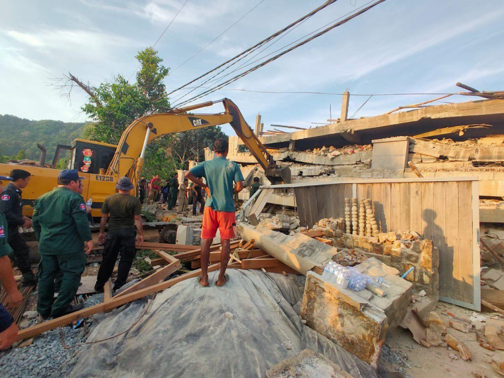 Photo provided by the Kep Province Authority Police, heavy machinery removes debris after a building collapsed in Kep province, Cambodia, Friday, Jan....