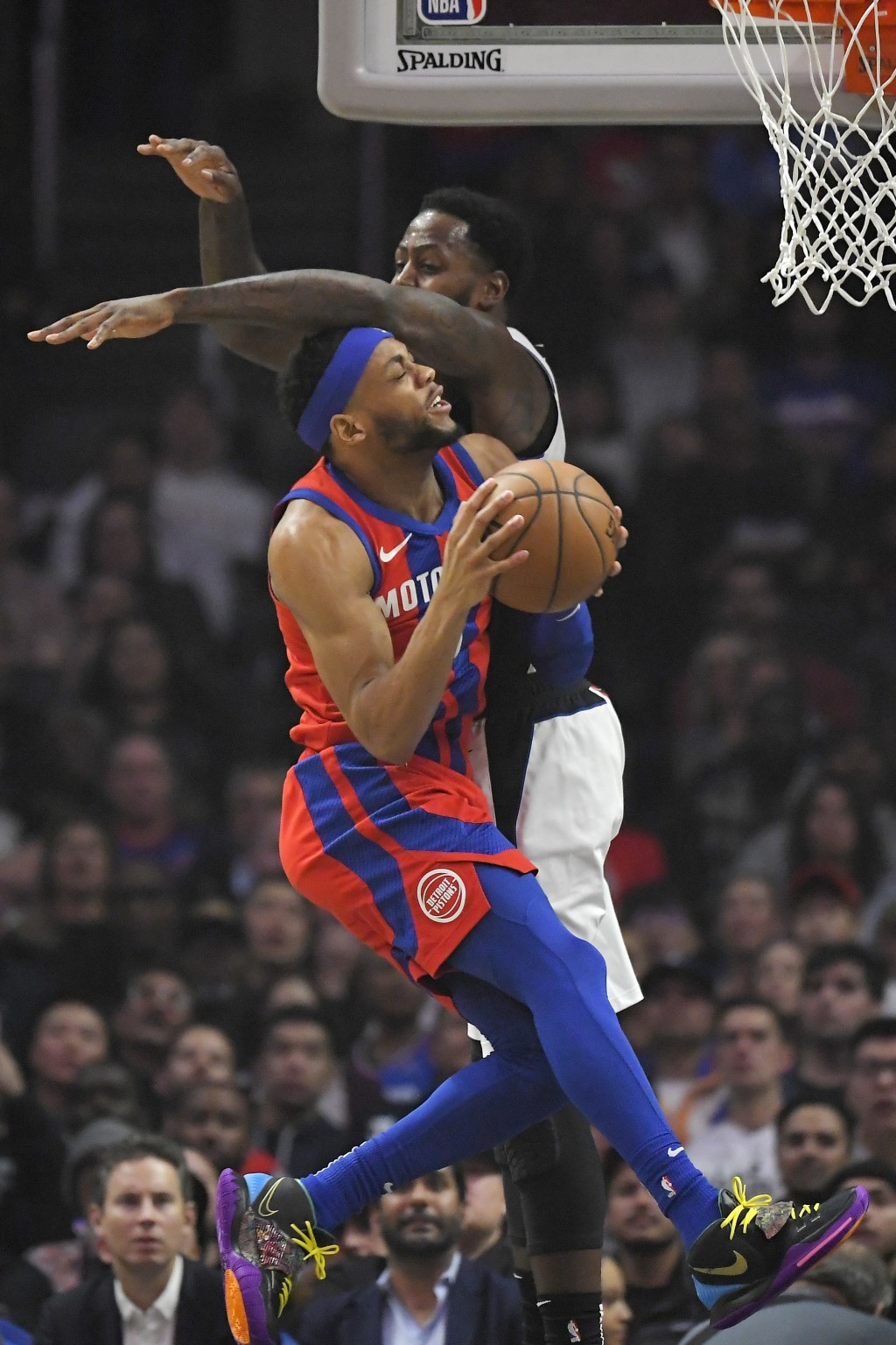 Detroit Pistons guard Bruce Brown, left, shoots as Los Angeles Clippers forward JaMychal Green defends during the first half of an NBA basketball game...