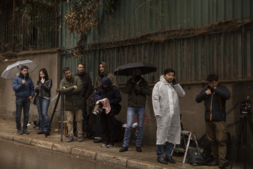 Journalists stake out the house of ex-Nissan chief Carlos Ghosn in Beirut, Lebanon, Friday, Jan. 3, 2020. The former Nissan Motor Co. Chairman fled Ja...