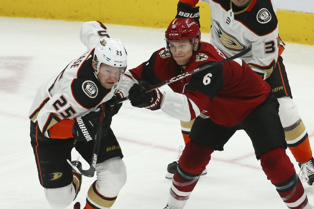 Arizona Coyotes defenseman Jakob Chychrun (6) gives Anaheim Ducks right wing Ondrej Kase (25) a shove during the second period of an NHL hockey game T...