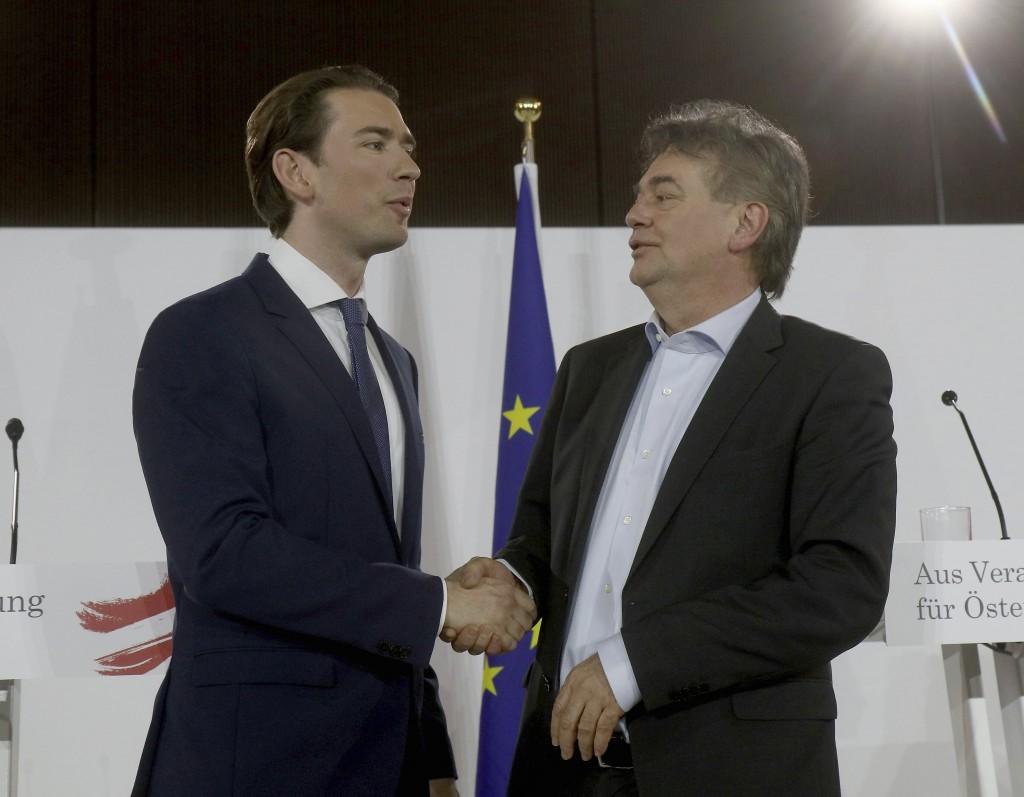 Sebastian Kurz, left, head of the Austrian People's Party, OEVP, shakes hands with Werner Kogler, right, head of the Austrian Greens after a press con...