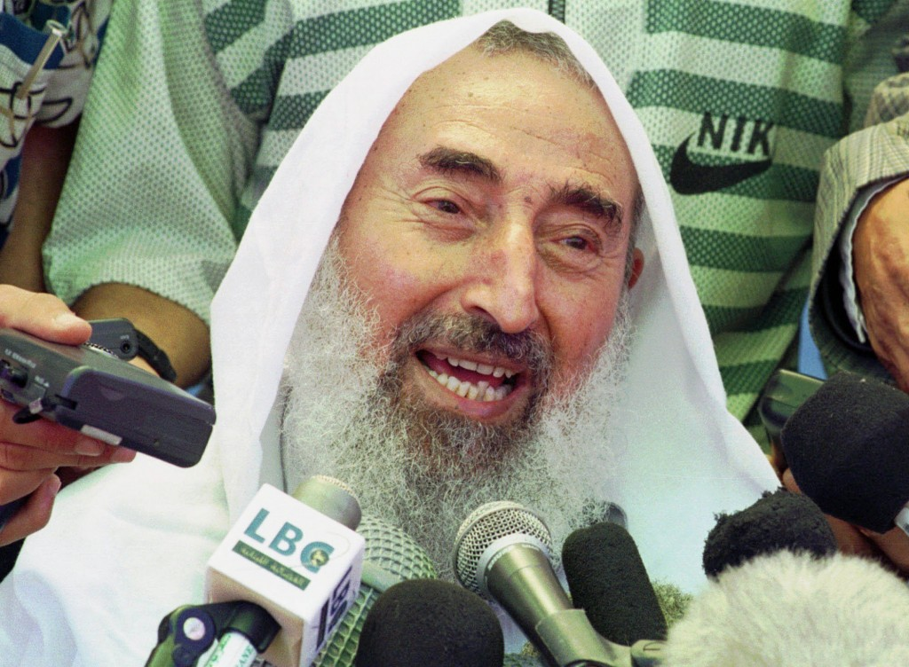 FILE - In this June 25, 1998 file photo, Sheik Ahmed Yassin, founder of the Islamic militant group Hamas, talks to the media during a celebration to w...
