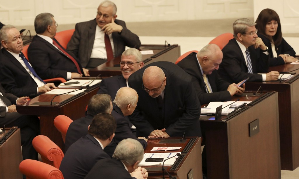 Nationalist lawmakers chat before Turkey's parliament authorized the deployment of troops to Libya to support the U.N.-backed government in Tripoli ba...
