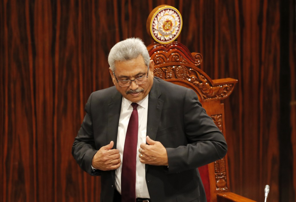 Sri Lankan President Gotabaya Rajapaksa leaves after addressing the parliament during the ceremonial inauguration of the session, in Colombo, Sri Lank...