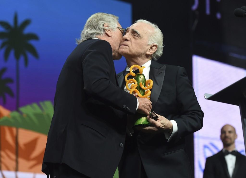 Robert De Niro, left, presents the Sonny Bono visionary award to Martin Scorsese at the 31st annual Palm Springs International Film Festival Awards Ga...