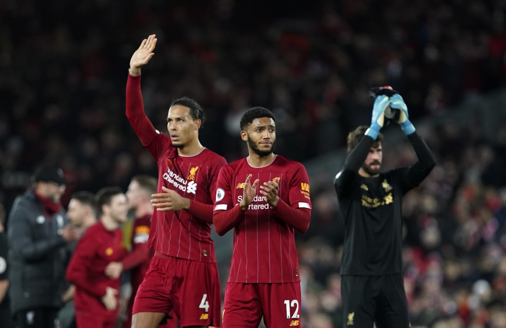 Liverpool players greet supporters at the end of the English Premier League soccer match between Liverpool and Sheffield United at Anfield Stadium, Li...