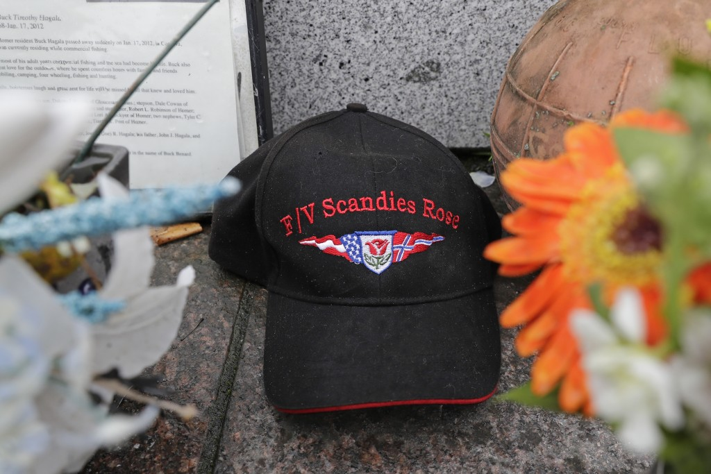 A ball cap with the name of the crab fishing boat Scandies Rose rests at the Seattle Fishermen's Memorial, Thursday, Jan. 2, 2020, in Seattle. The sea...