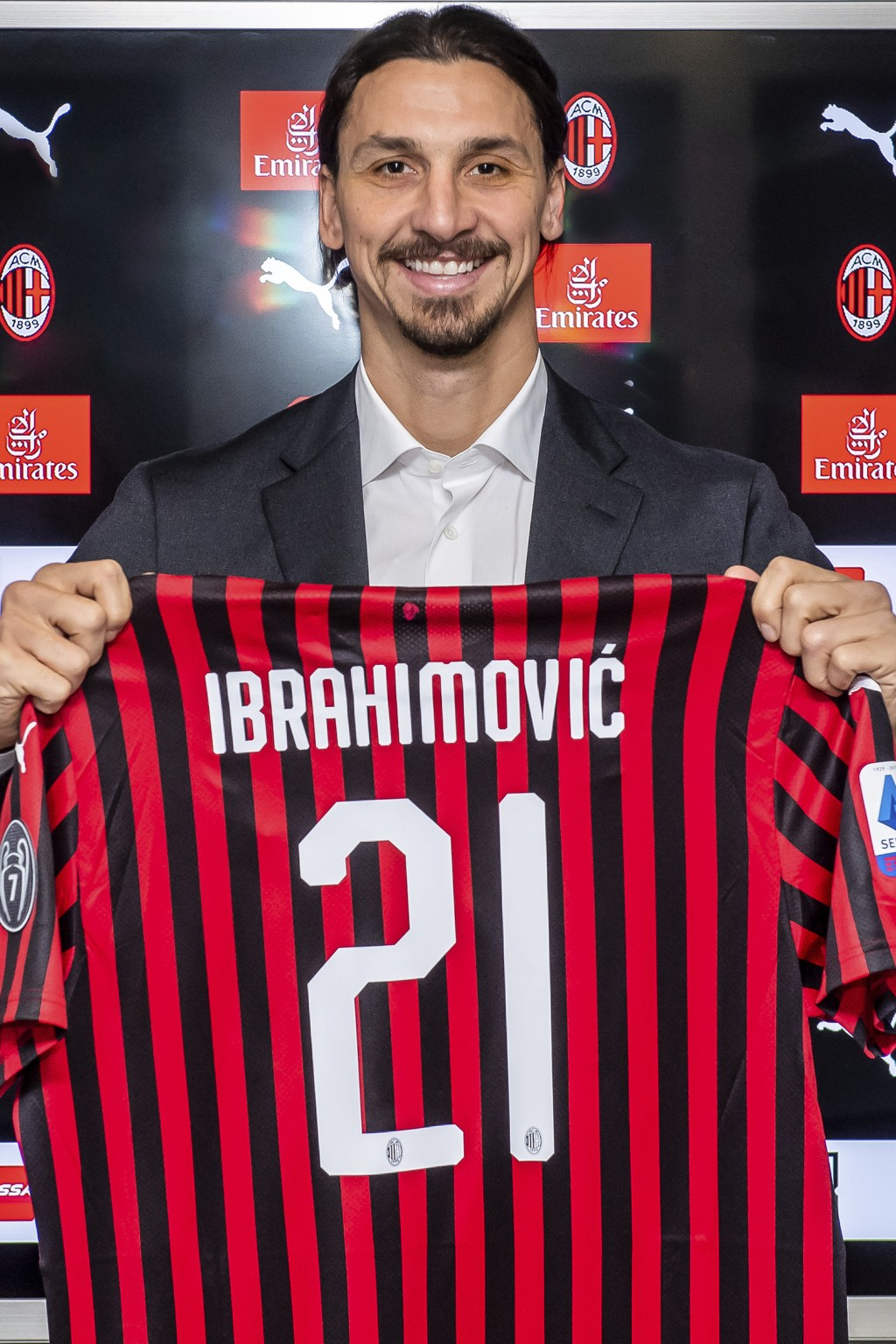 Zlatan Ibrahimovic holds an AC Milan jersey as he poses for photos at the team's headquarters, in Milan, Italy, Thursday, Jan. 2, 2020.  The 38-year-o...