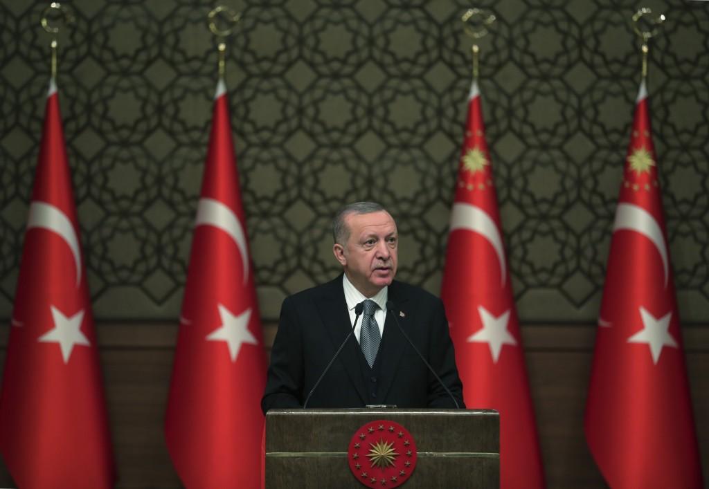 Turkey's President Recep Tayyip Erdogan deliver a speech at an event in Ankara, Turkey, Thursday, Jan. 2, 2020. Turkey's parliament on Thursday author...