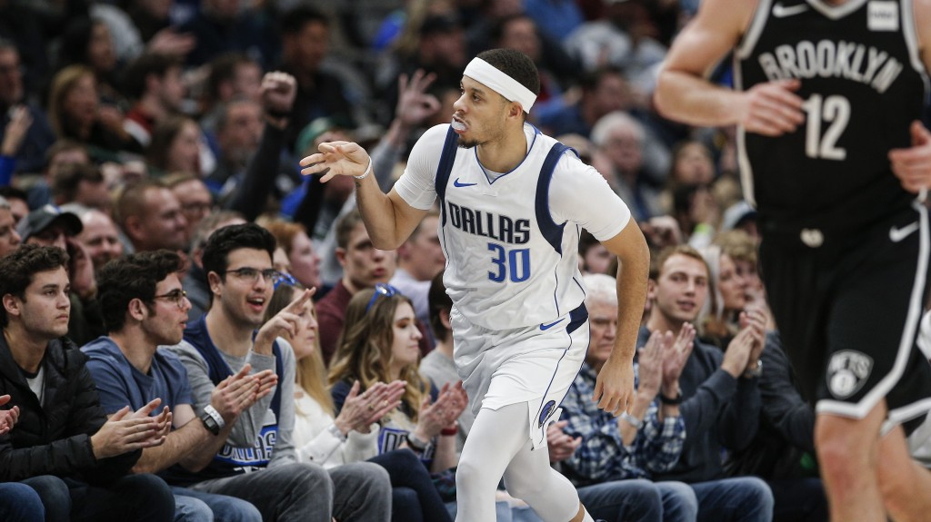 Dallas Mavericks guard Seth Curry (30) celebrates a 3-point shot during the second half of the team's NBA basketball game against the Brooklyn Nets on...