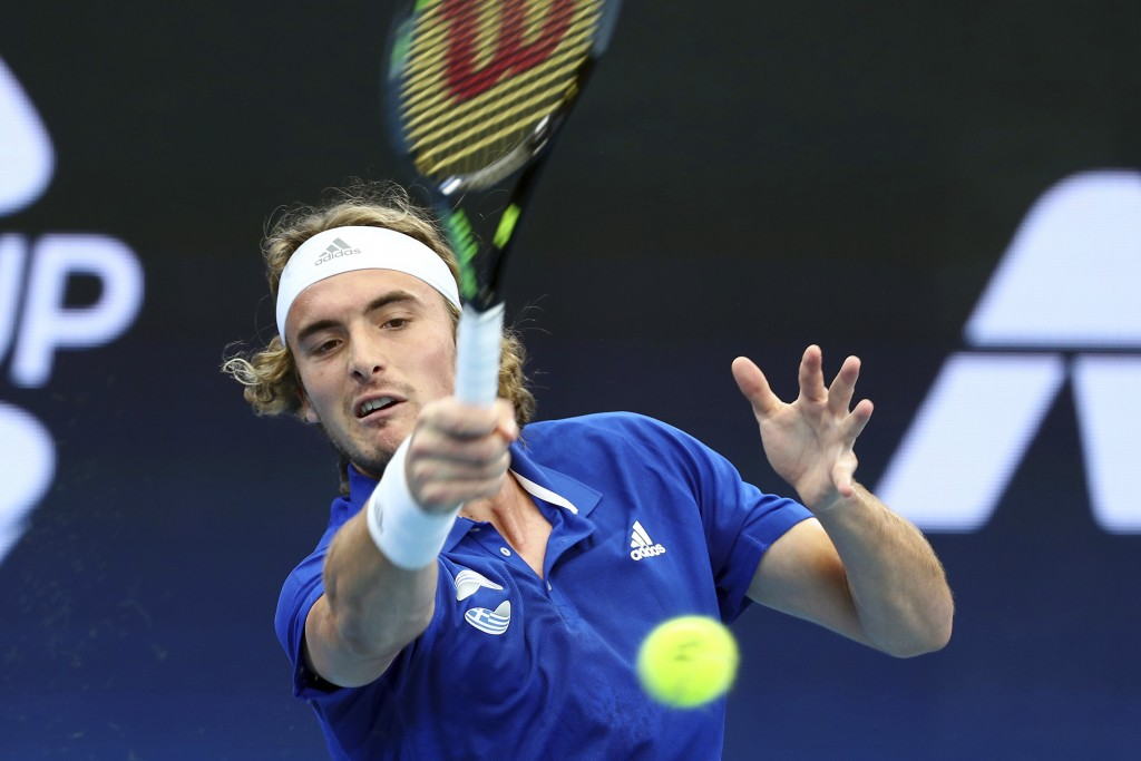 Stefanos Tsitsipas of Greece plays a shot during his match against Denis Shapovalov of Canada at the ATP Cup tennis tournament in Brisbane, Australia,...