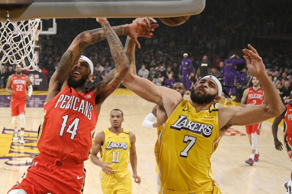 New Orleans Pelicans forward Brandon Ingram, left, is fouled while shooting by Los Angeles Lakers center JaVale McGee during the first half of an NBA ...