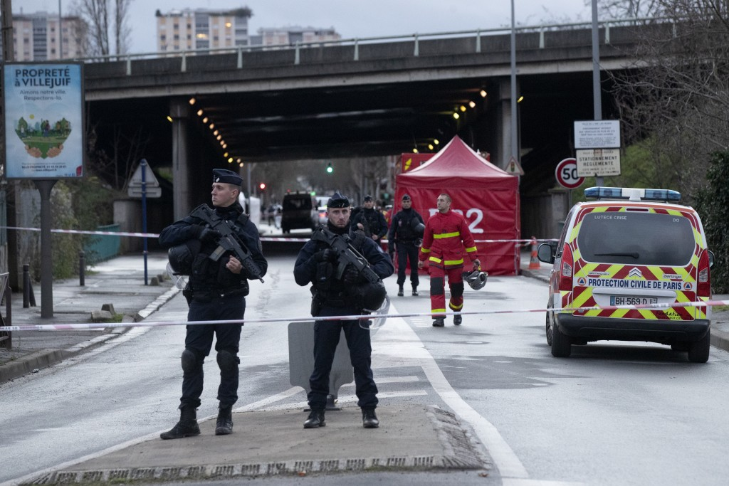 Riot police officers secure the area after a man attacked passerby Friday Jan.3, 2020 in Villejuif, south of Paris. A man armed with a knife rampaged ...