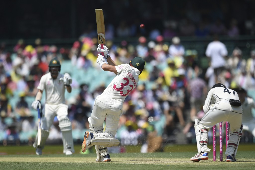 Australia's Marnus Labuschagne hits a boundary on day two of the third cricket test match between Australia and New Zealand at the Sydney Cricket Grou...