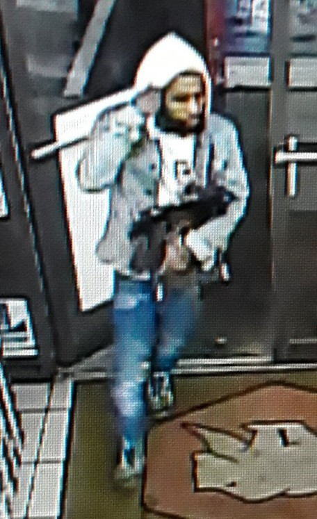 This image provided by the Lafourche Parish Sheriff Office shows a suspect entering a convenience store in Galliano, La. Louisiana authorities are try...