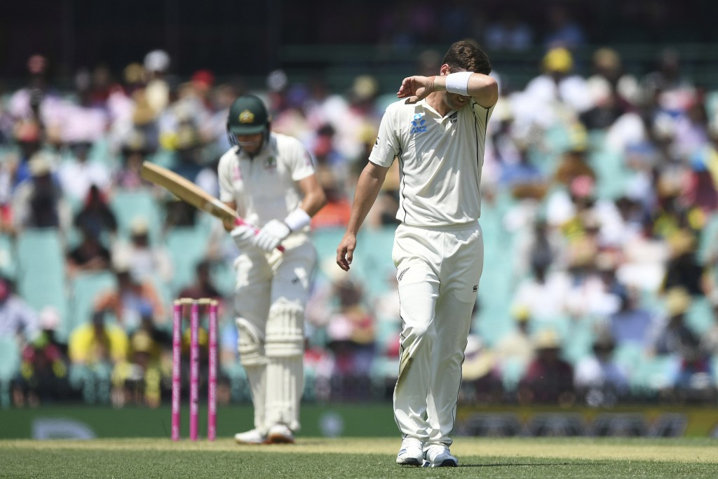 New Zealand's Matt Henry, right, feels the heat on day two of the third cricket test match between Australia and New Zealand at the Sydney Cricket Gro...
