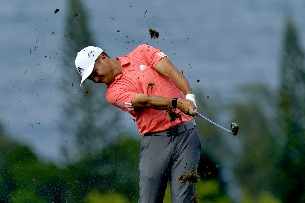 Xander Schauffele hits from the fourth fairway during second round of the Tournament of Champions golf event, Friday, Jan. 3, 2020, at Kapalua Plantat...