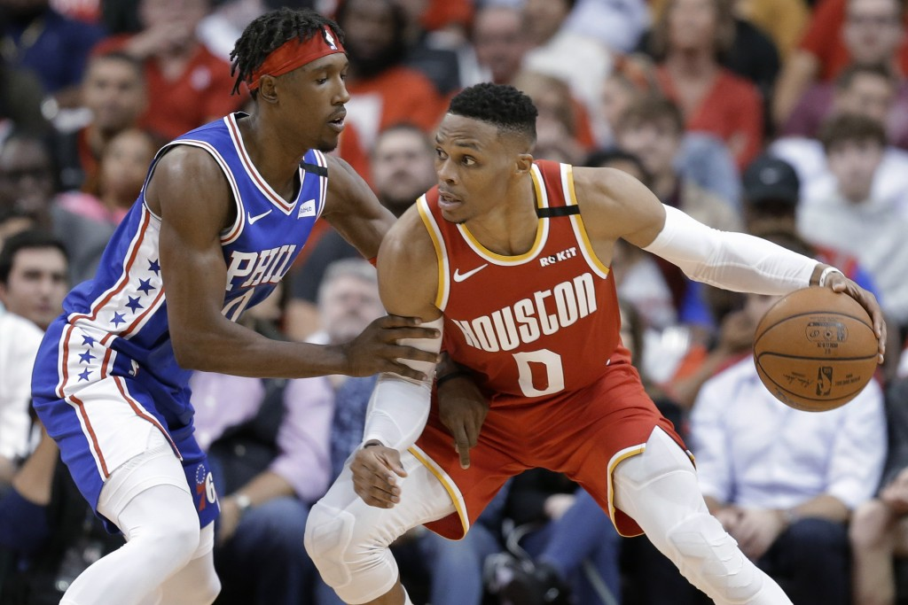 Houston Rockets guard Russell Westbrook (0) dribbles as Philadelphia 76ers guard Josh Richardson defends during the second half of an NBA basketball g...
