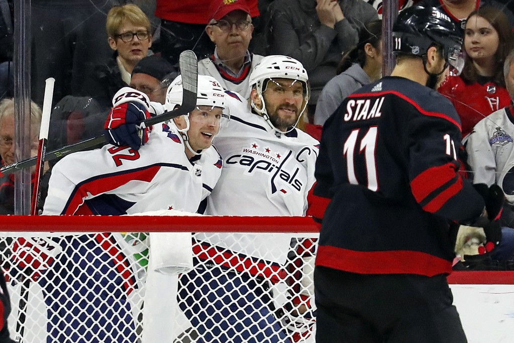 Washington Capitals' Evgeny Kuznetsov (92), of Russia, is congratulated on his goal by teammate Alex Ovechkin (8), of Russia, with Carolina Hurricanes...