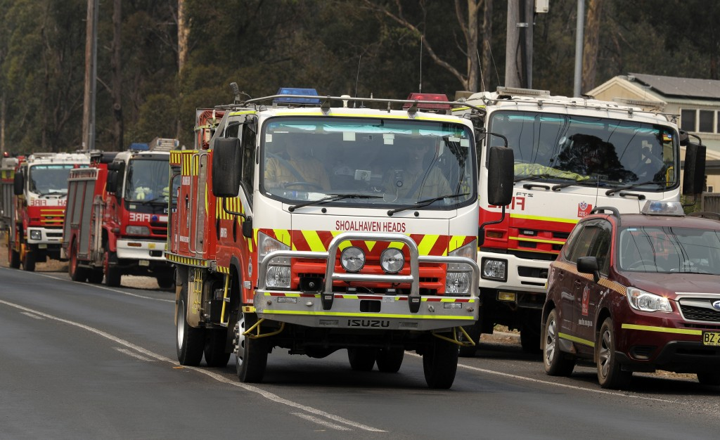 Firetrucks at staging area at Nowra, Australia, prepare to disperse to fires, Saturday, Jan. 4, 2020. Australia was bracing for one of the worst days ...