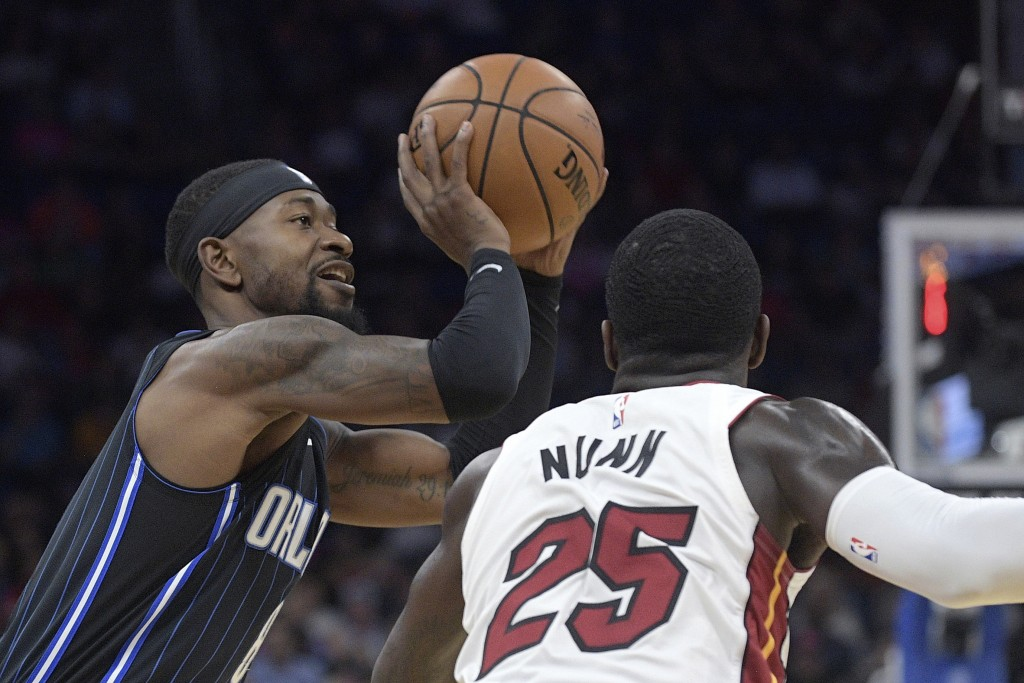 Orlando Magic guard Terrence Ross (8) goes up to shoot in front of Miami Heat guard Kendrick Nunn (25) during the first half of an NBA basketball game...