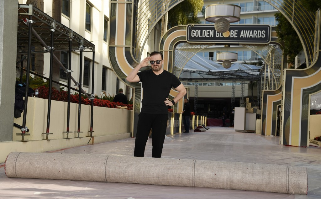 Ricky Gervais, host of this Sunday's 77th Annual Golden Globe Awards, salutes the media before rolling out the red carpet on Preview Day for the Globe...