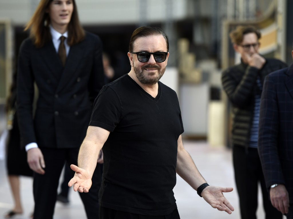 Ricky Gervais, host of the 77th Annual Golden Globe Awards, reacts to photographers during Preview Day for the Globes at the Beverly Hilton, Friday, J...