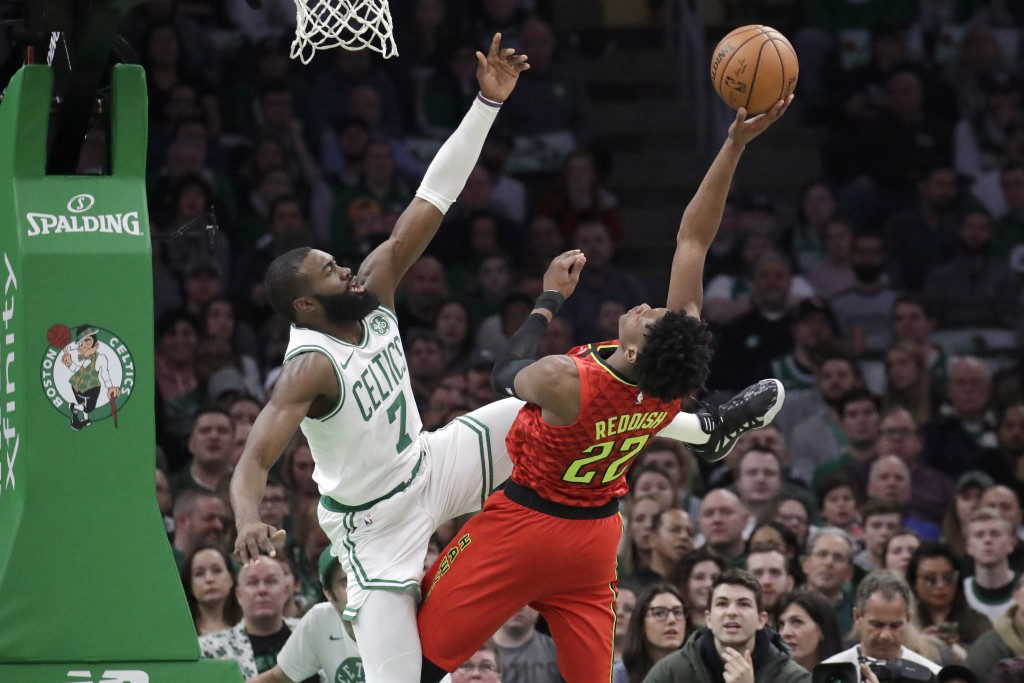 Atlanta Hawks forward Cam Reddish (22) shoots against Boston Celtics guard Jaylen Brown (7) during the first quarter of an NBA basketball game Friday,...