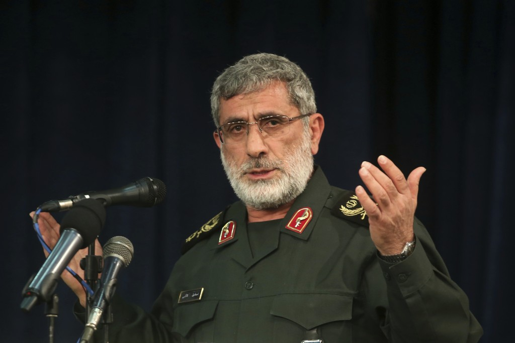 In this Nov. 5, 2016 photo, Gen. Esmail Ghaani speaks in a meeting in Tehran, Iran. A new Iranian general has stepped out of the shadows to lead the c...