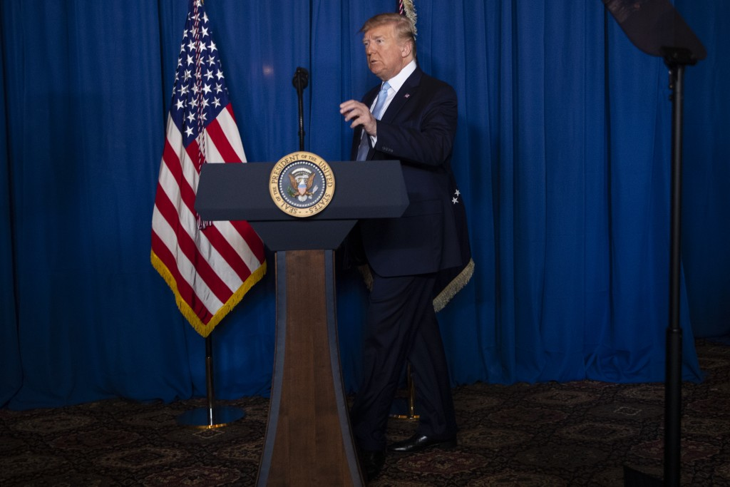 President Donald Trump arrives to deliver remarks on Iran, at his Mar-a-Lago property, Friday, Jan. 3, 2020, in Palm Beach, Fla. (AP Photo/ Evan Vucci...