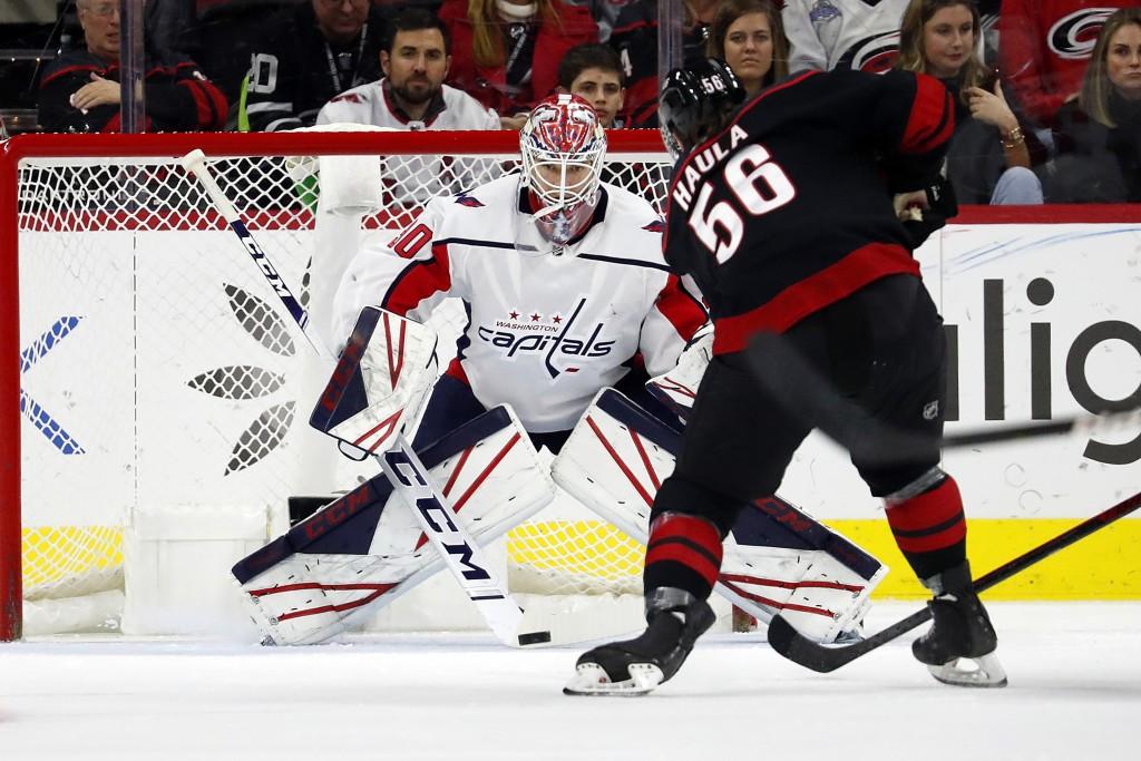 Washington Capitals goaltender Ilya Samsonov (30), of Russia, blocks the shot of Carolina Hurricanes' Erik Haula (56) during the first period of an NH...