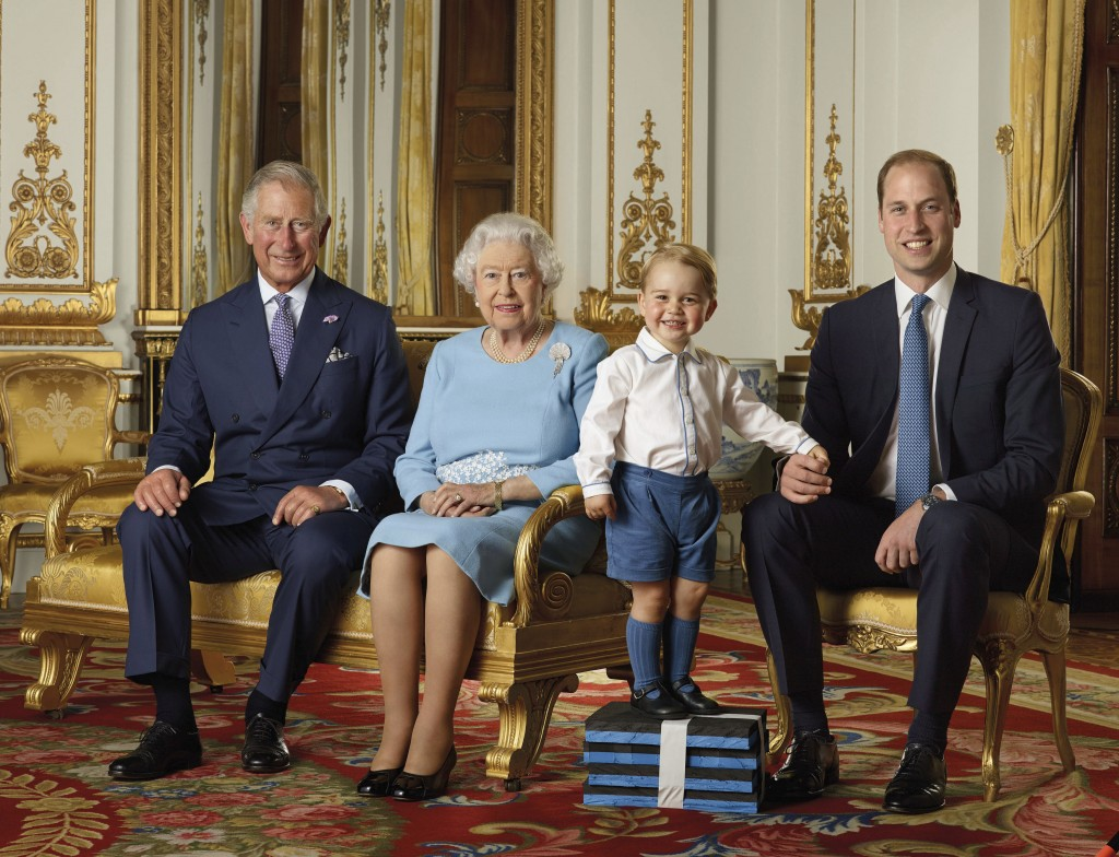 FILE - In this file handout photo provided by Buckingham Palace and released in 2016, Britain's Queen Elizabeth, Prince Charles, Prince William and Pr...