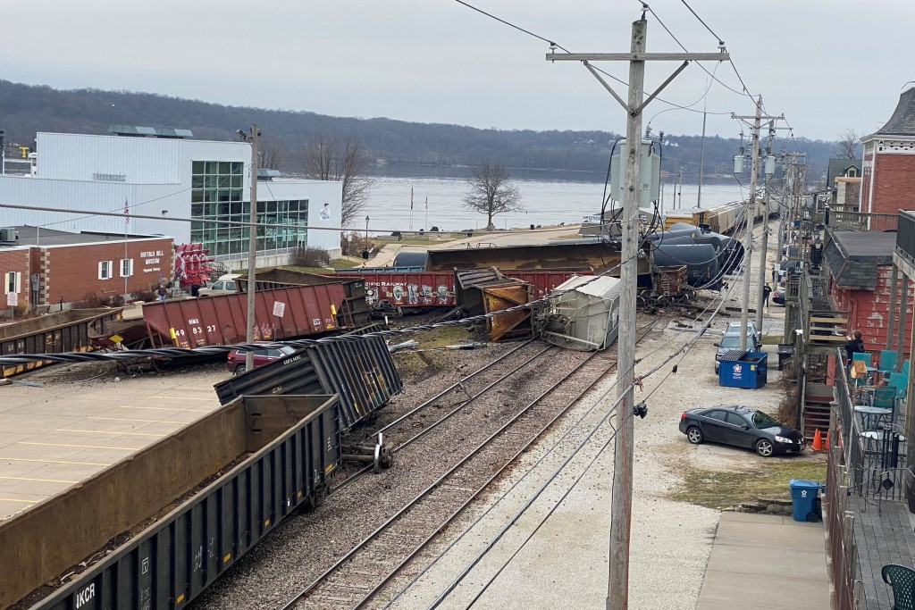This photo provided by Ryan Burchett of the Mississippi River Drilling Company, shows a train derailment Friday, Jan. 3, 2020, that sent at least a do...