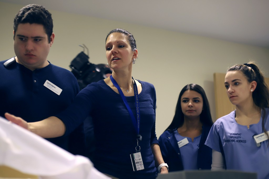 Tania Grgurich, clinical associate professor of diagnostic imaging at Quinnipiac University, talks with university students about scanning skeletal re...