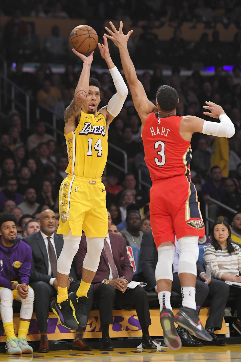 Los Angeles Lakers guard Danny Green, left, shoots as New Orleans Pelicans guard Josh Hart defends during the first half of an NBA basketball game Fri...