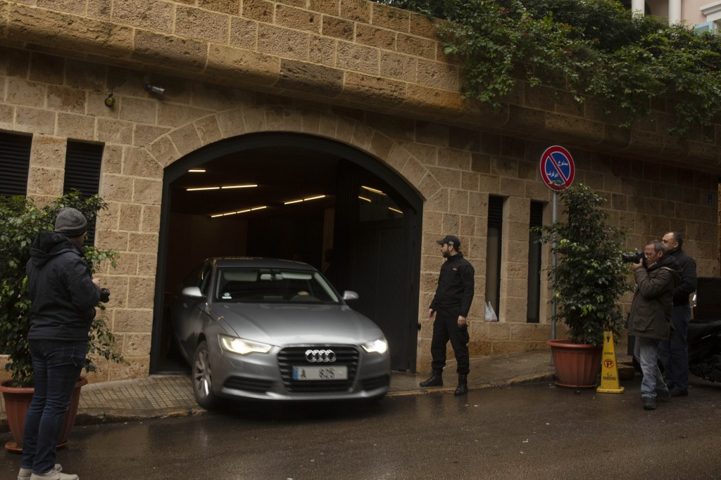 A vehicle leaves the house of ex-Nissan chief Carlos Ghosn in Beirut, Lebanon, Saturday, Jan. 4, 2020. Ghosn earlier this week jumped bail in Japan an...