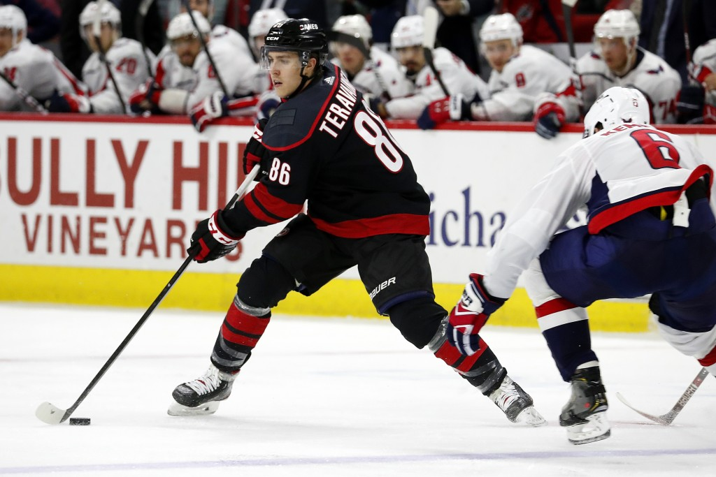 Carolina Hurricanes' Teuvo Teravainen (86), of Finland, moves the puck next to Washington Capitals' Michal Kempny (6), of the Czech Republic, during t...