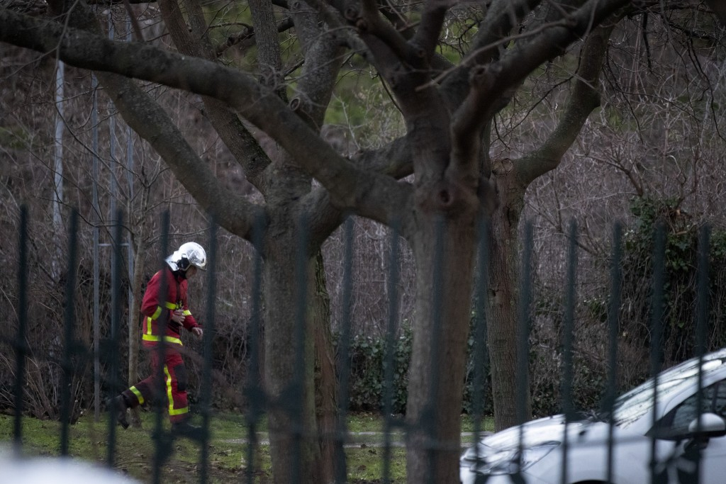 A rescue worker walks in a park after a man attacked passerby Friday Jan.3, 2020 in Villejuif, south of Paris. A man armed with a knife rampaged throu...