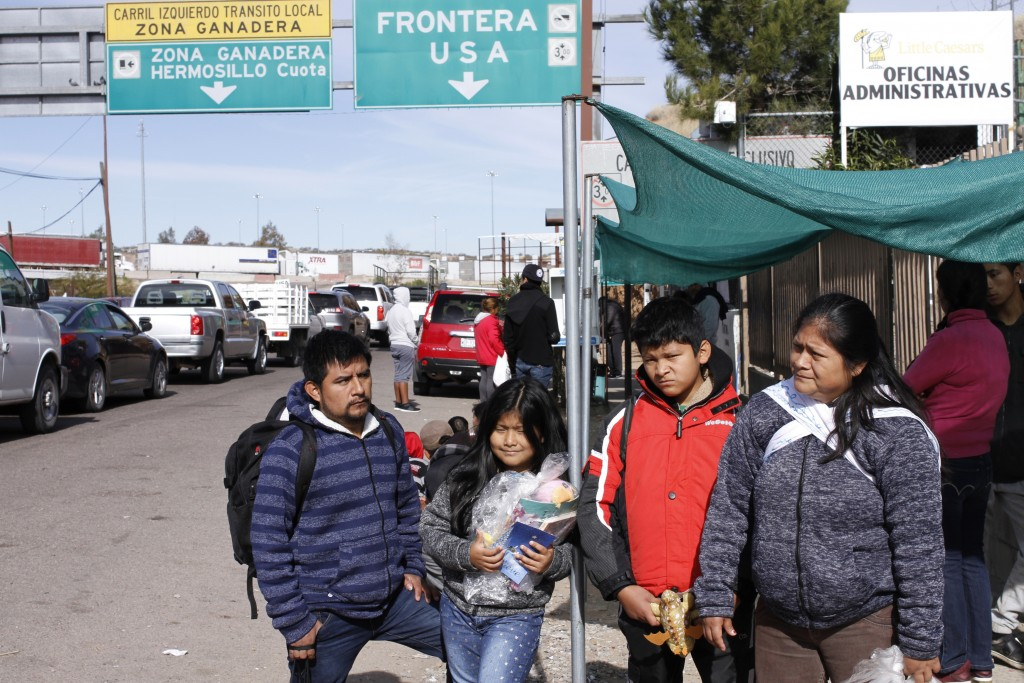 The Gonzalez family of five from Guatemala, who are applying for asylum in the U.S., stand for a family portrait before going to a soup kitchen to eat...