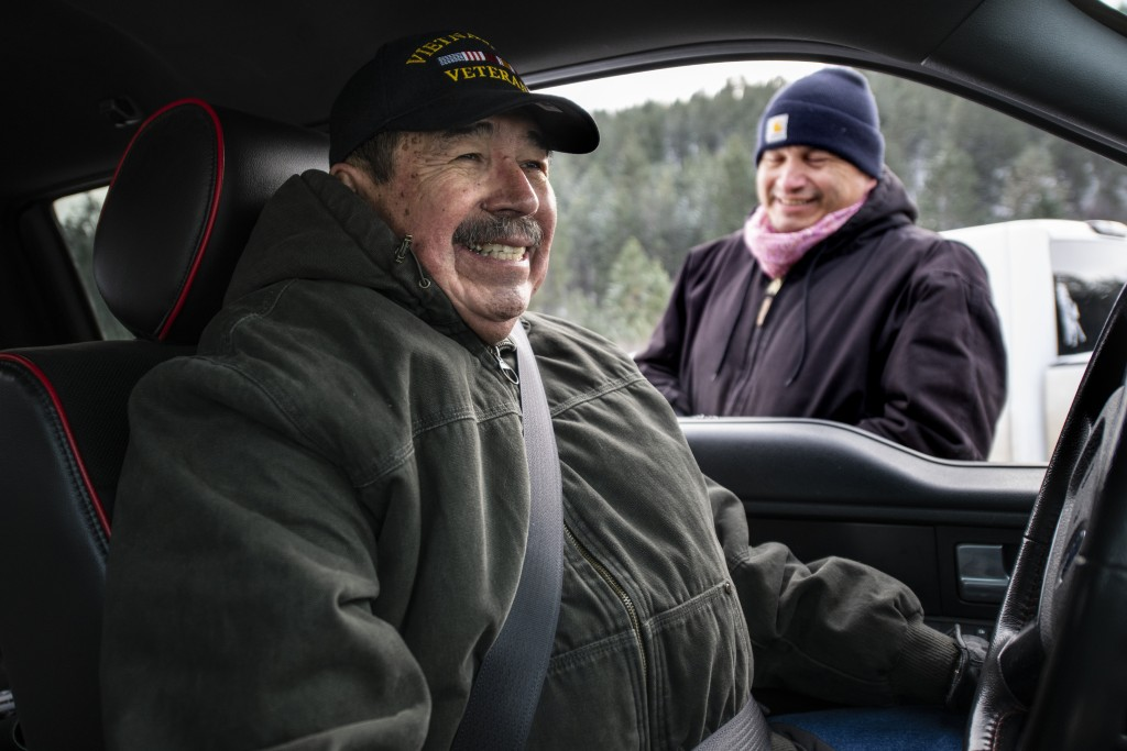 Richard King, 70, left, and his brother, Brent, laugh together while Brent takes a break searching for a Christmas tree on the King family ranch on Su...
