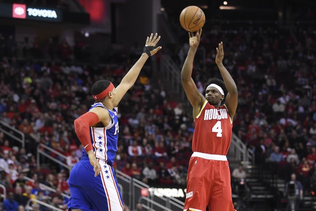 Houston Rockets forward Danuel House Jr. (4) shoots as Philadelphia 76ers forward Tobias Harris defends during the first half of an NBA basketball gam...