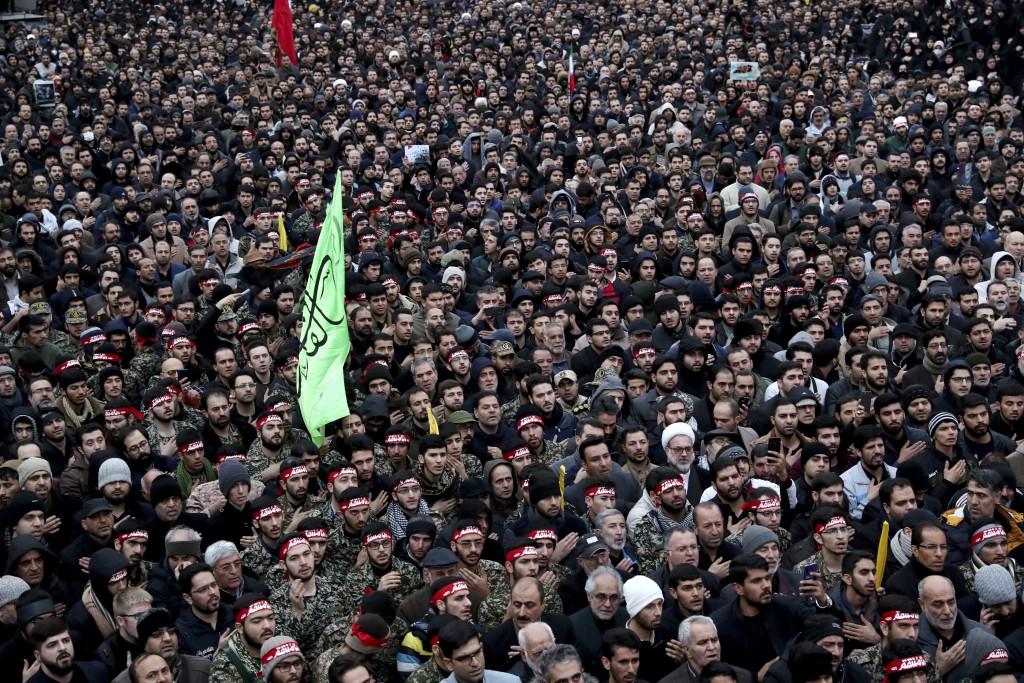 Protesters demonstrate over the U.S. airstrike in Iraq that killed Iranian Revolutionary Guard Gen. Qassem Soleimani in Tehran, Iran, Saturday Jan. 4,...