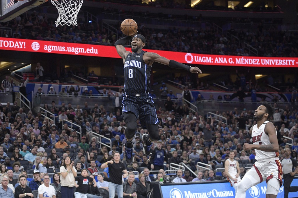Orlando Magic guard Terrence Ross (8) goes up for a breakaway dunk in front of Miami Heat forward Derrick Jones Jr., right, during the second half of ...