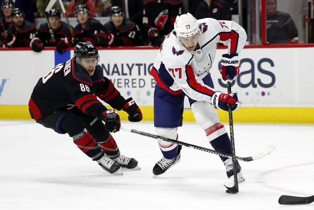 Carolina Hurricanes' Teuvo Teravainen (86), of Finland, tries to block the shot of Washington Capitals' T.J. Oshie (77) during the first period of an ...