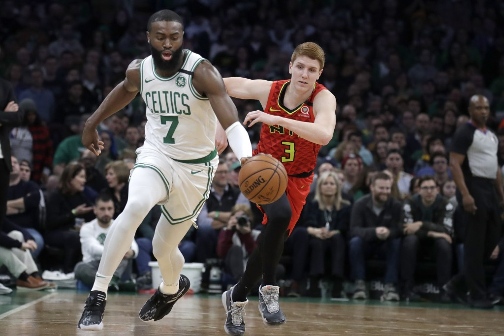 Boston Celtics guard Jaylen Brown (7) brings the ball up next to Atlanta Hawks guard Kevin Huerter (3) during the first quarter of an NBA basketball g...