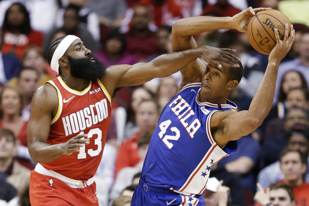 Philadelphia 76ers center Al Horford (42) looks to pass the ball as Houston Rockets guard James Harden defends during the first half of an NBA basketb...